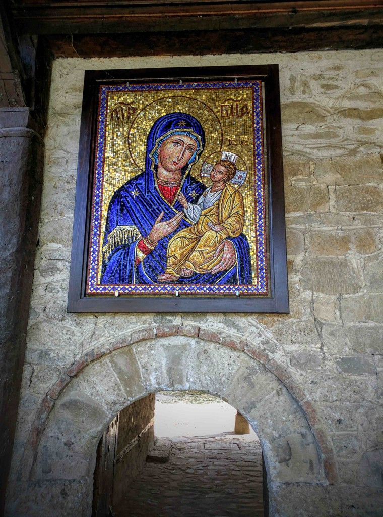 Roman-style mosaic of virgin Mary and baby Christ.