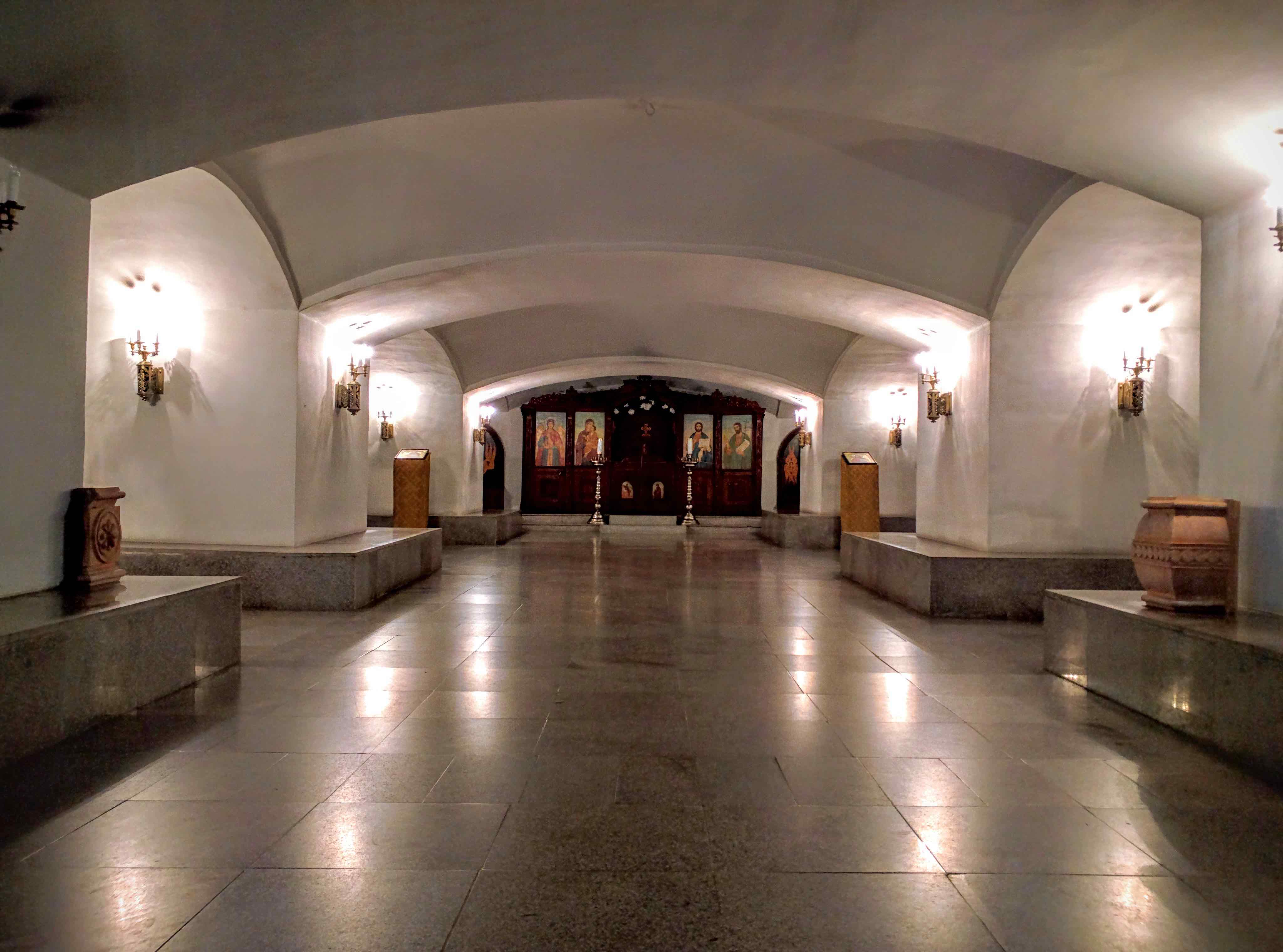 The crypt of the Shipka Memorial Church. Along the two sides are multiple sarcophagi.